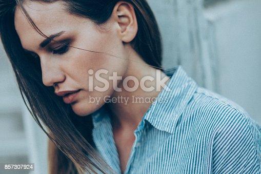 istock Sad woman 857307924