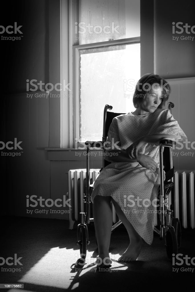 Sad Woman Sitting in Hospital Wheelchair royalty-free stock photo