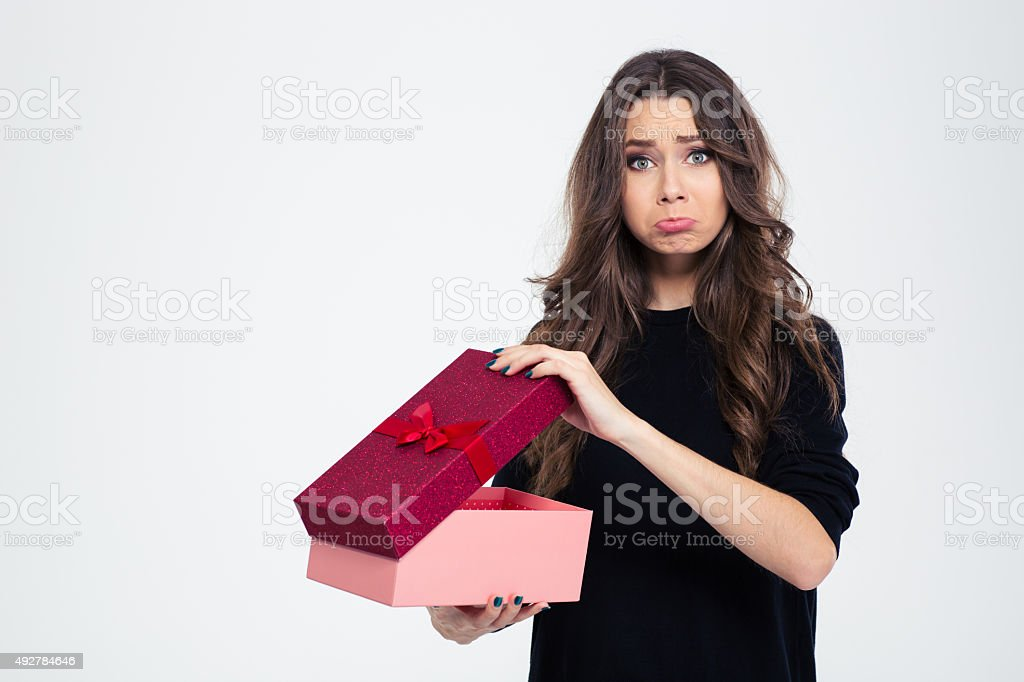 Sad woman standing with opened gift box stock photo