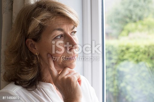 istock Sad Woman Suffering From Agoraphobia Looking Out Of Window 811453972