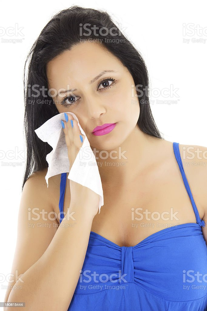 sad woman wipes her face royalty-free stock photo