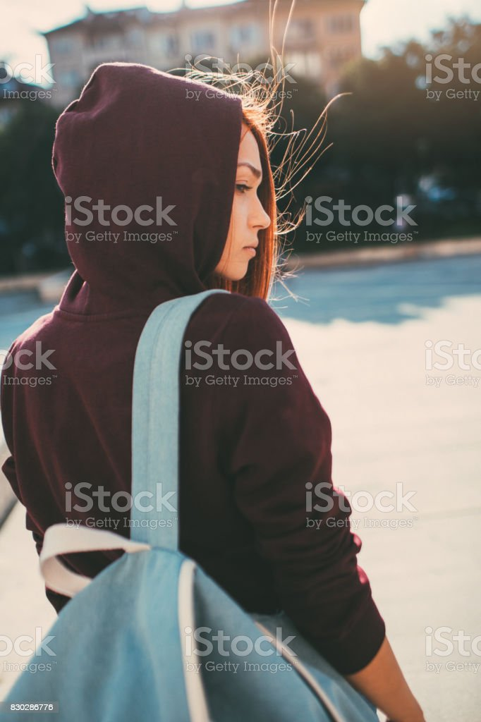 Sad woman with a backpack stock photo