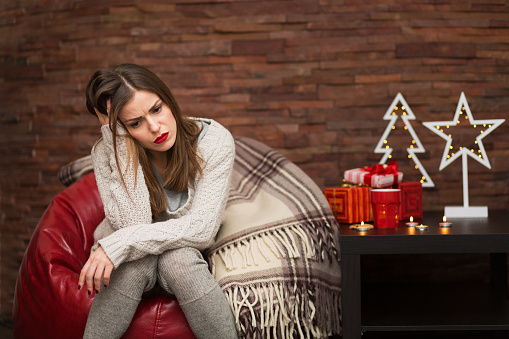 Sad Woman With Gift Boxes Stock Photo - Download Image Now
