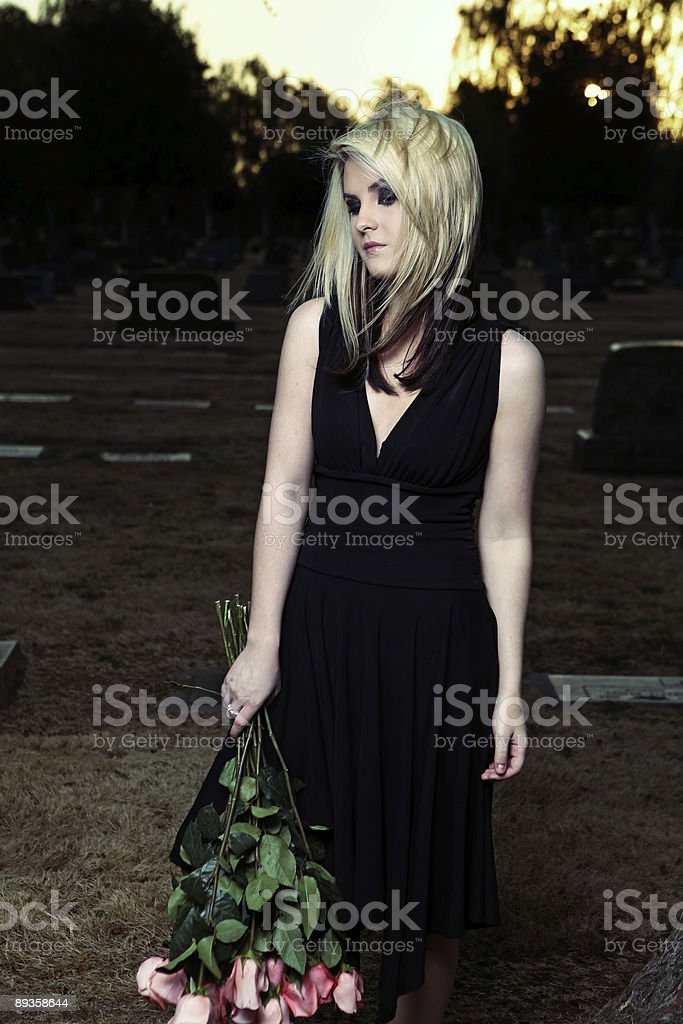 Sad Woman with Roses at Sunset royalty free stockfoto