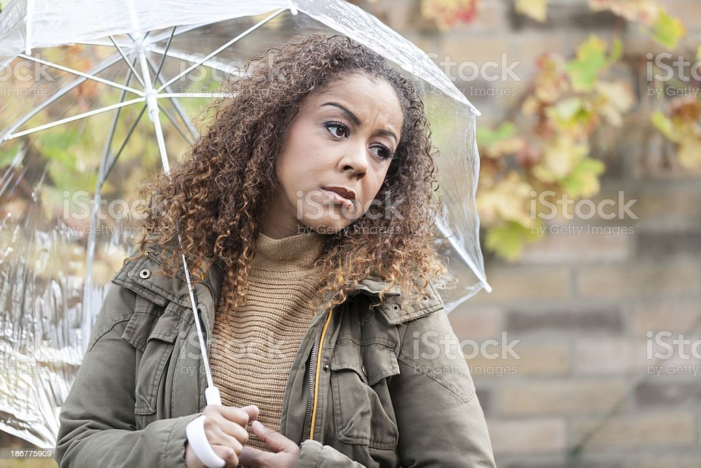 Sad woman with umbrella stock photo