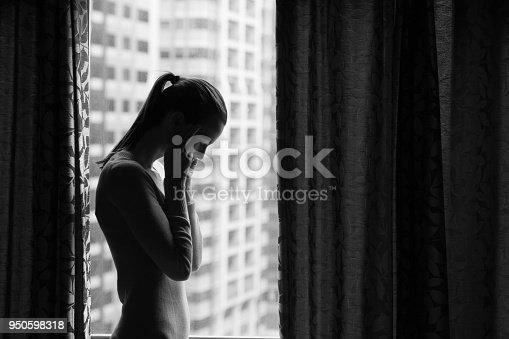 istock Sad women in the city 950598318
