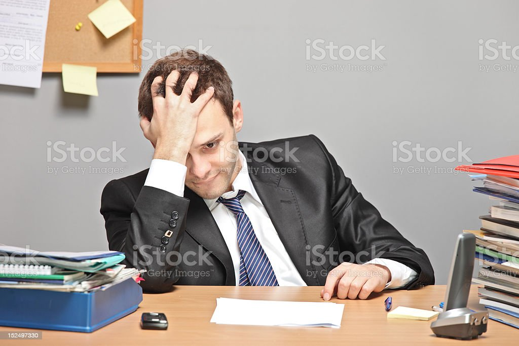 Sad worker royalty-free stock photo