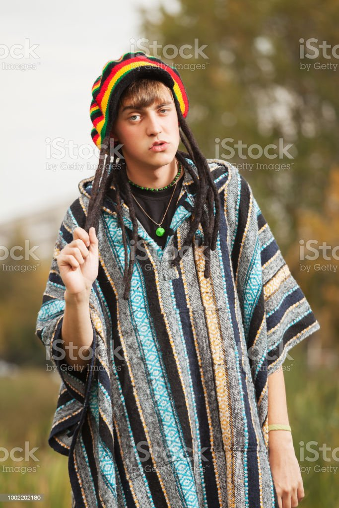 Sad young fashion hippie man walking outdoor stock photo