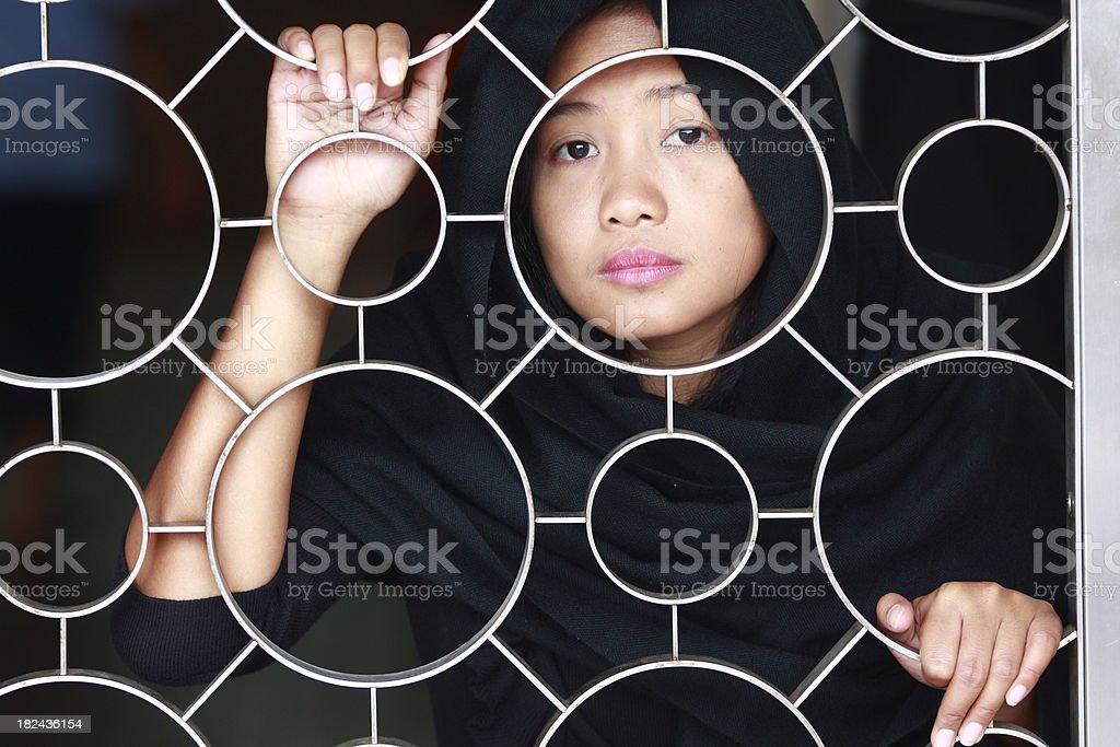 sad young girl looking at camera royalty-free stock photo