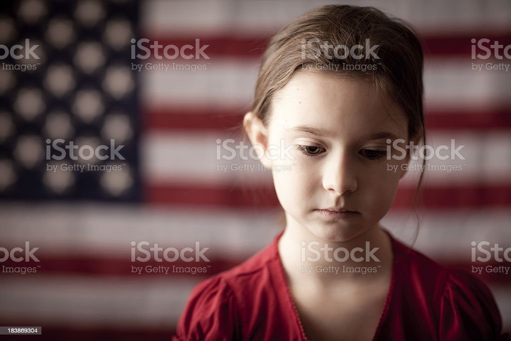Sad Young Girl Thinking in Front of American Flag royalty-free stock photo