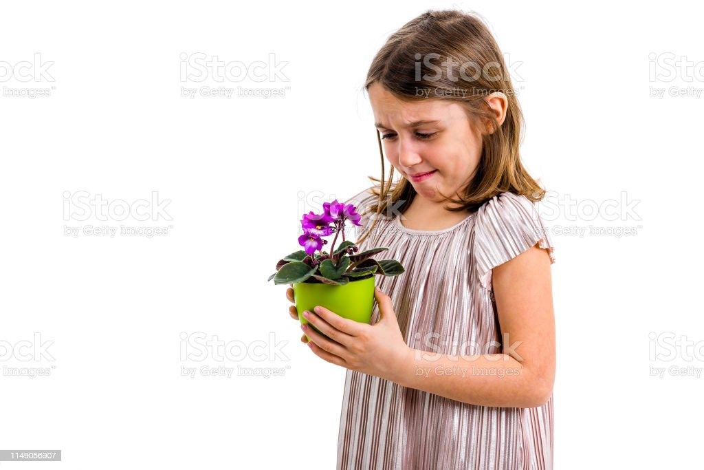 Little Sad Girl Holding Flowers Her Stock Photo (Edit Now