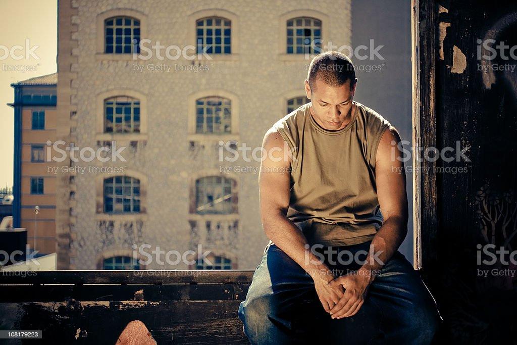 Sad Young Man Sitting Outside royalty-free stock photo