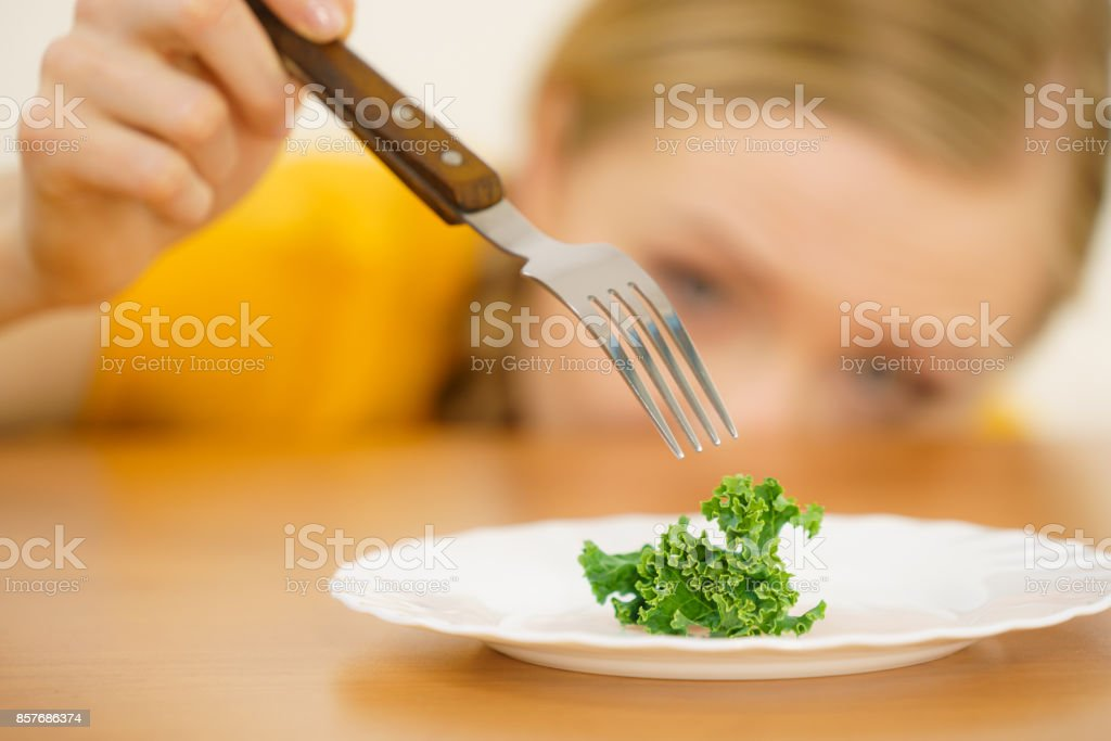 Sad young woman being on diet stock photo