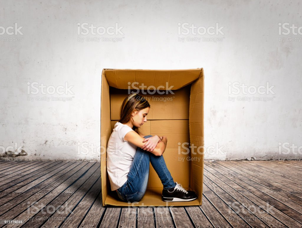 sad young woman inside a Box stock photo