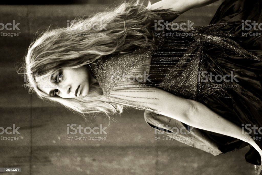 Sad young woman looking over shoulder royalty-free stock photo