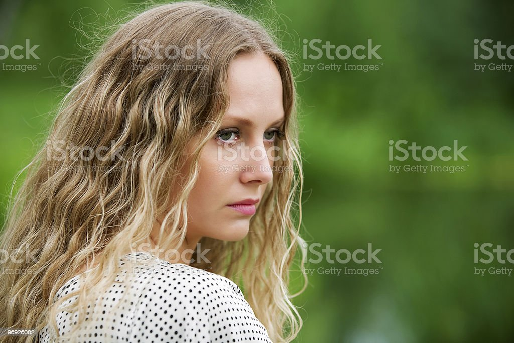 Sad young woman on nature royalty-free stock photo