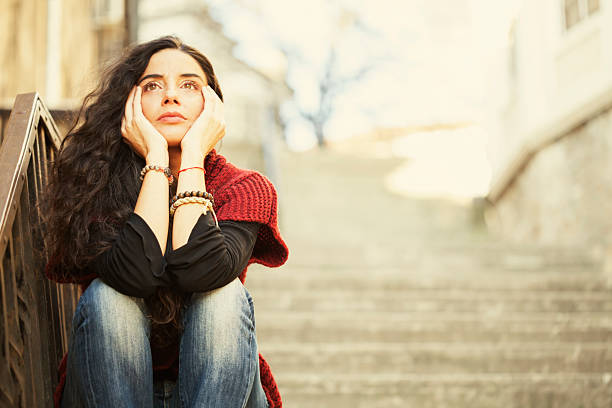 Sad young woman stock photo
