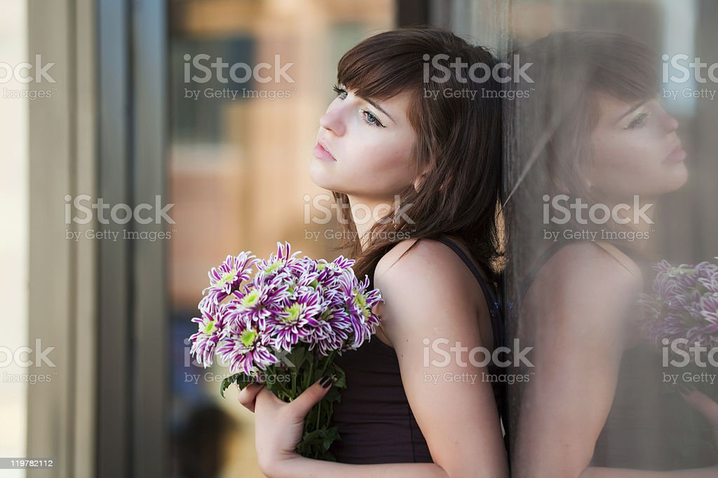 Sad Young Woman With A Chrysanthemums Stock Photo More