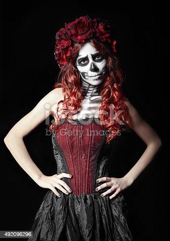 The sad young woman with calavera makeup (sugar skull)