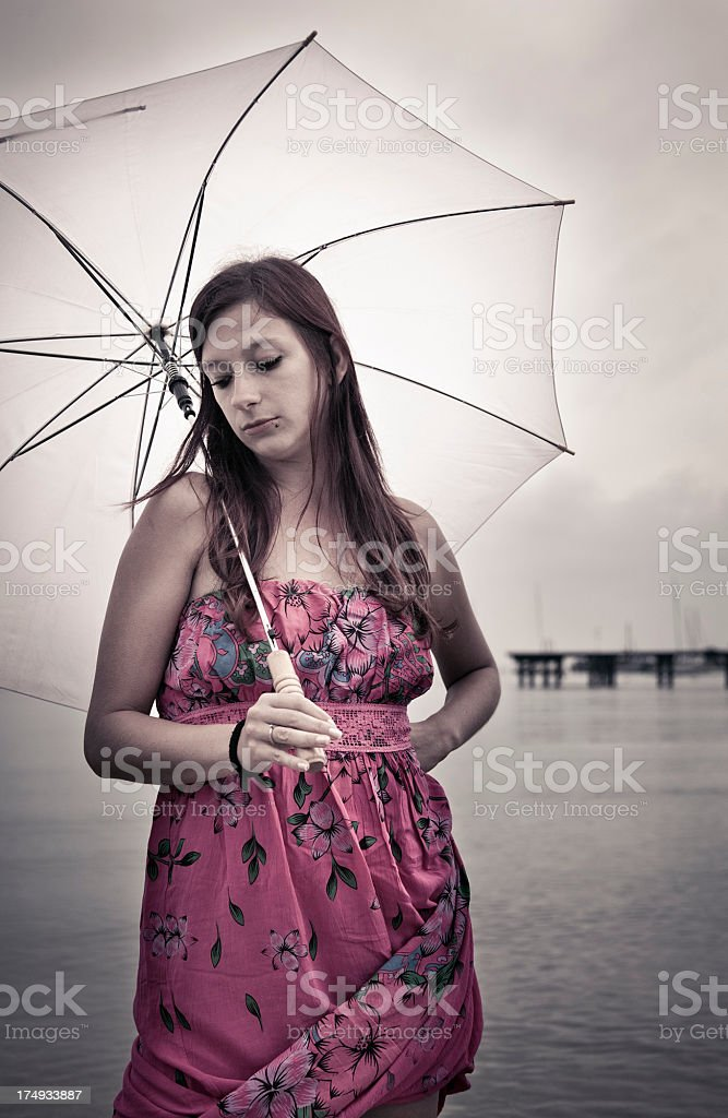 Sad young woman with umbrella stock photo