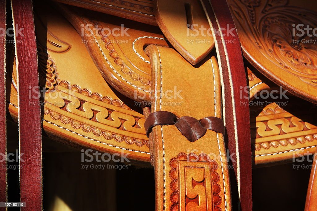 Soporte de cuero de los Cowboys Riding pegado - foto de stock