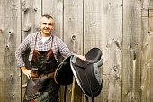 A saddle maker with one of his handmade saddles.