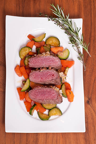Saddle of a lamb with rosmary and thyme stock photo