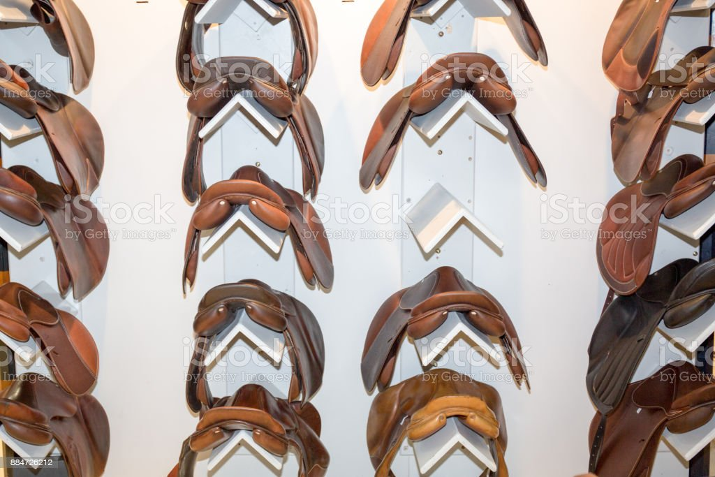 Saddle orse sold in a market shop on white stock photo