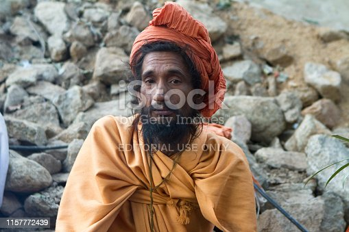 Vastanji, India - January 08, 2014: holy man at Muni maharaj Temple in vastanji village, Sadhu devoted his whole life in meditation after wear Saffron religion apparel in india, muni maharaj festival held once in every year, all india holy man togther at vastanji temple at this time in muni maharaj festival
