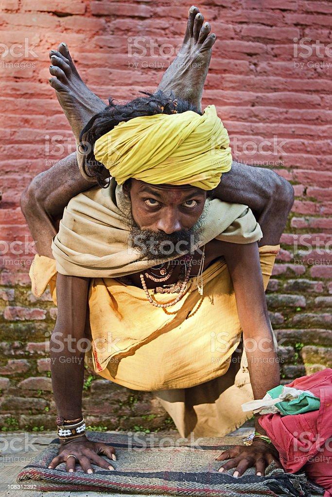 Sadhu - holy man practicing yoga stock photo