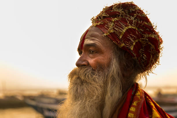Sadhu in Varanasi, India A sadhu also spelled saddhu, is a religious ascetic, mendicant (monk) or any holy person in Hinduism and Jainism who has renounced the worldly life. yogi stock pictures, royalty-free photos & images