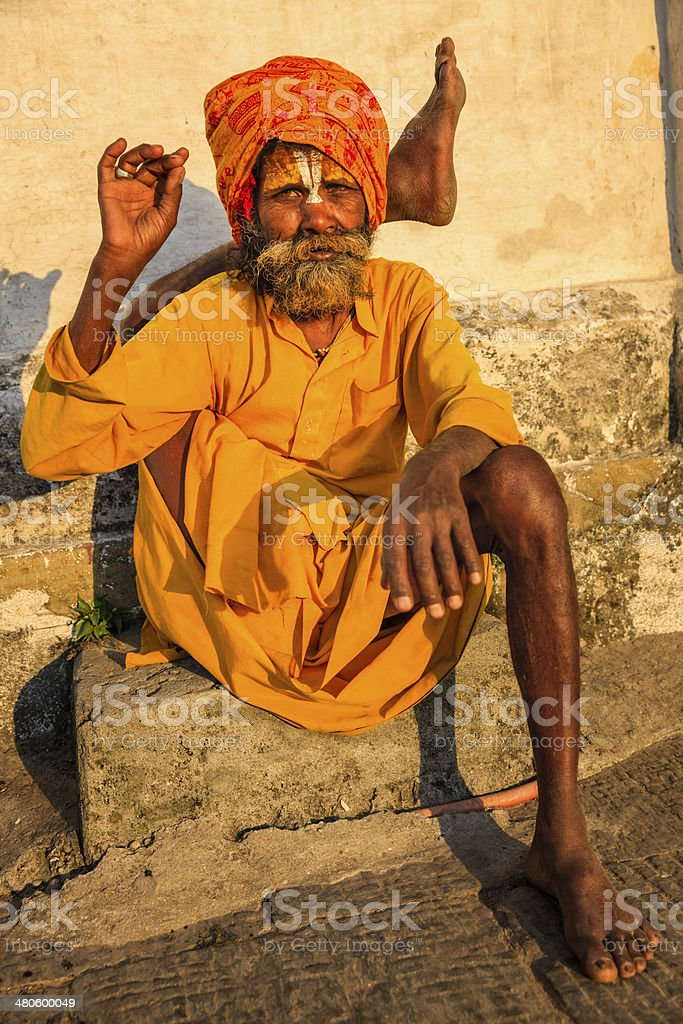 Sadhu - indian holyman practicing yoga in the temple stock photo