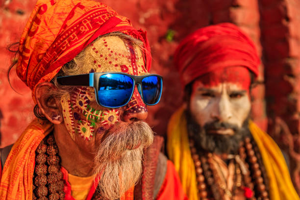 sadhu - indian holymen sitting in the temple - hinduism stock photos and pictures
