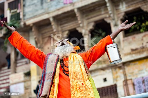 VARANASI - INDIA - 13 NOVEMBER 2017. A Sadhu is posing for a photo on the Ghat in Varanasi, India. Shadu is a religious ascetic, mendicant (monk) or any holy person in Hinduism and Jainism who has renounced the worldly life.