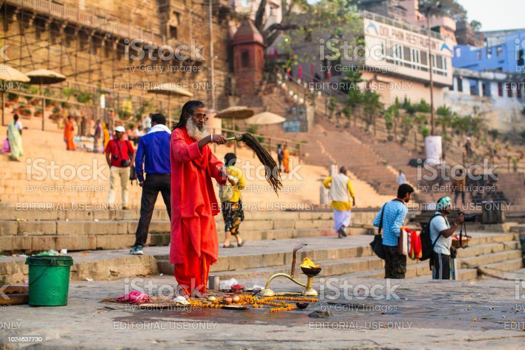 Sadhu or Baba on the ghats of Ganges river in Varanasi. stock photo