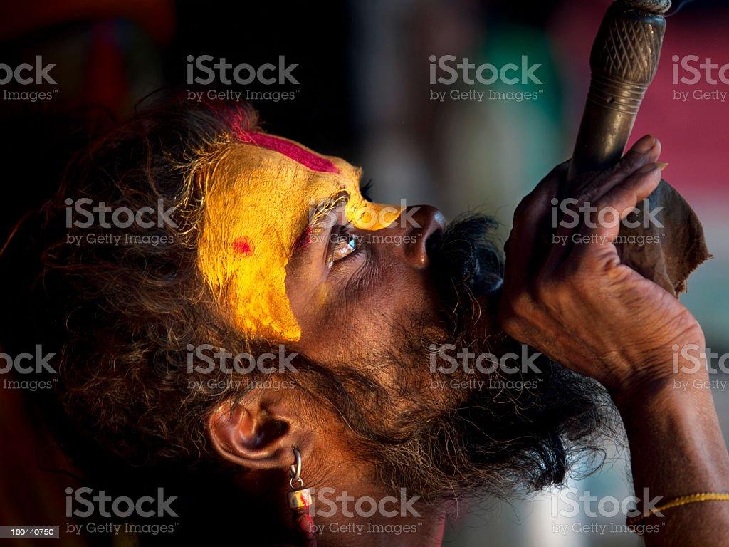Sadhu smoking hashish. royalty-free stock photo