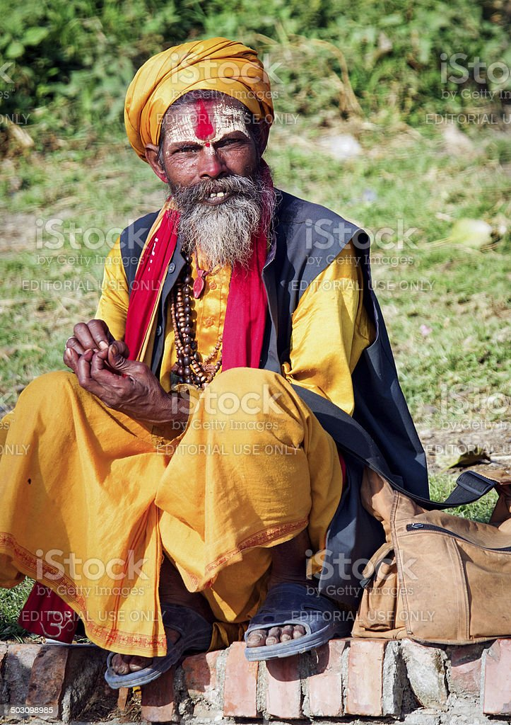 Sadhu with traditional painted face , Nepal stock photo