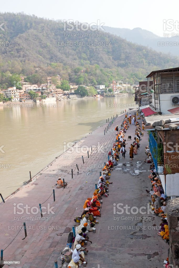 India, Laxman Jhula - April 24, 2017: Sadhus waiting for food at the river Ganges in Laxman Jhula on 24th april 2017 royalty-free stock photo