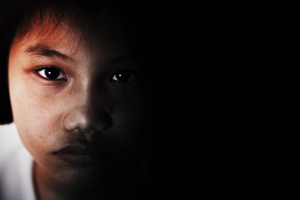 sadness and depress girl, absent minded, Child Abuse in white tone sadness and depress girl, absent minded, Child Abuse in white tone trafficking stock pictures, royalty-free photos & images