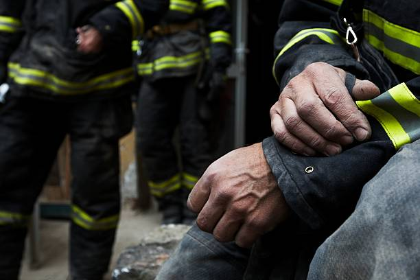 sadness and hope - firefighter stock photos and pictures