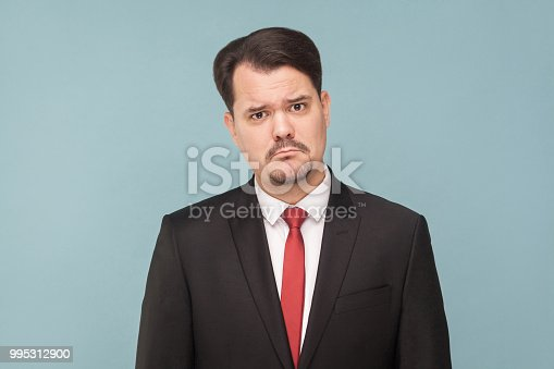 1162960006istockphoto Sadness and lonely business man 995312900