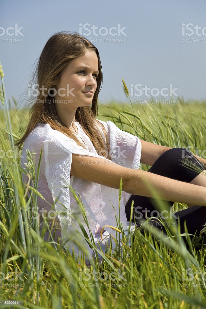 Sadness girl sitting on grass royalty-free stock photo