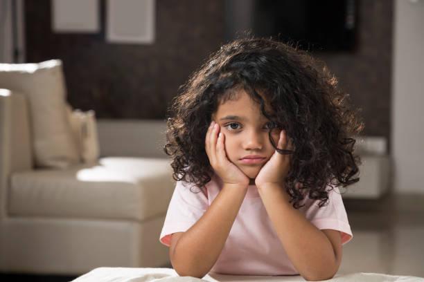 sadness little girl - stock images - noia foto e immagini stock