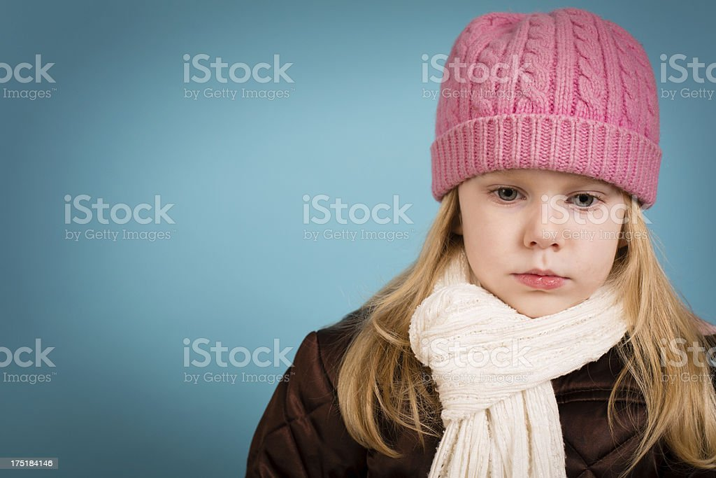 Sad/Thinking Little Girl Wearing Warm Clothing, With Copy Space royalty-free stock photo