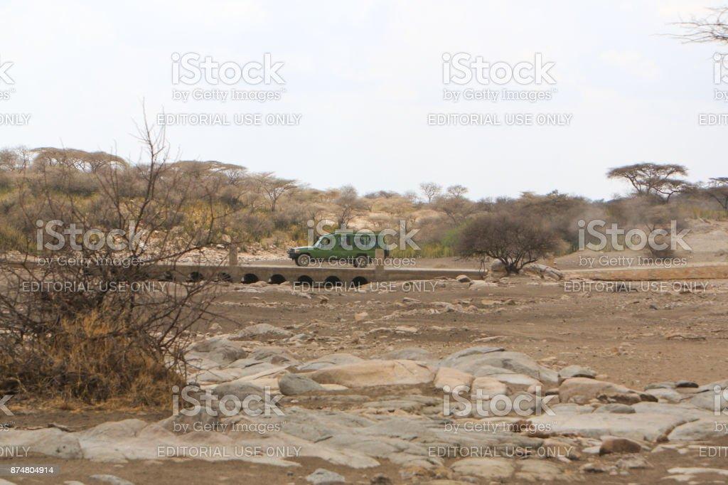 Ngorongoro Crater, Tanzania – September 17, 2017: Safari car crossing...