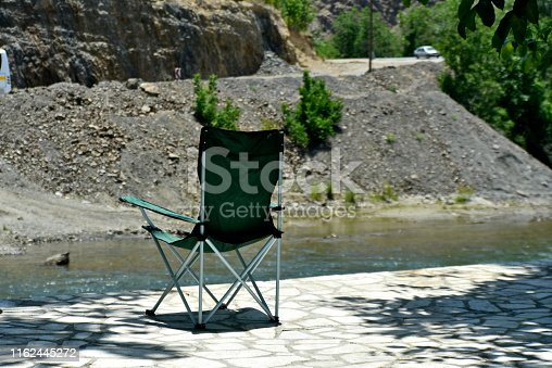 Safari Chair with the View of Zayandeh rood (Zayanderud), Esfahan, Iran at the day
