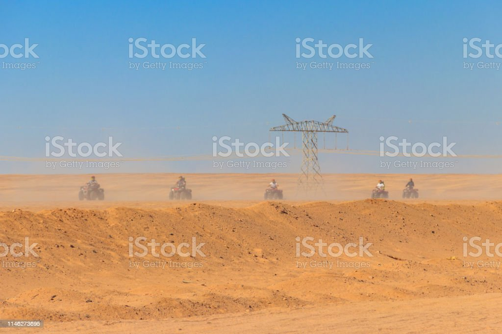Safari trip through egyptian desert driving ATV. Quad bikes safari in...