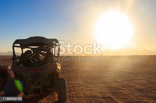 istock Safari trip through egyptian desert driving buggy cars 1130045143