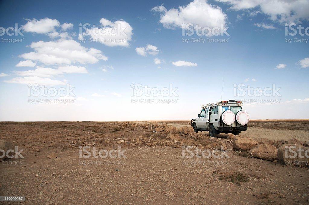 Safari truck at a dirt road royalty-free stock photo