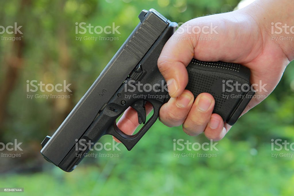 Safe Action with a gun stock photo